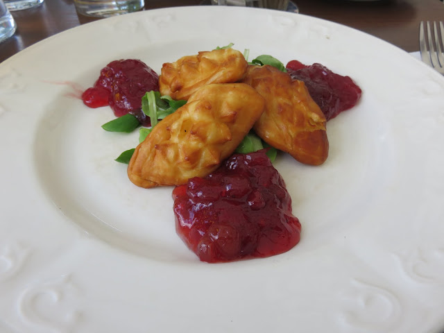 Modern Warsaw food: Smoked cheese and cranberries