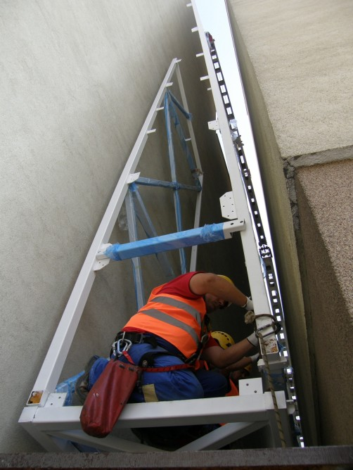 Picture of construction worker working on the steel cage for the world's narrowest house