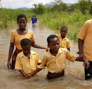 Students in Suleja, Lagos State swimming to school in flood.