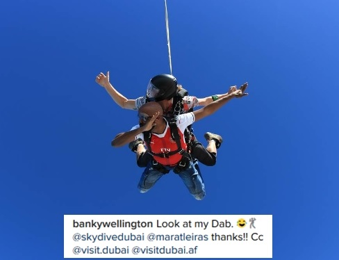 Singer, Banky W 'Dabs' in the Sky as He Jumps Off a Helicopter During Skydiving in Dubai (Photos)