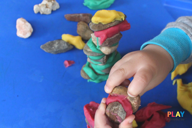Sticking rocks together with playdough