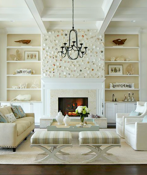 Shell Wall above Fireplace in an Elegant White Coastal ...