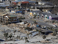 The devastation from Hurricane Michael over Mexico Beach, Fla. A massive federal report released in November warns that climate change is fueling extreme weather disasters like hurricanes and wildfires. (Credit: Gerald Herbert/AP) Click to Enlarge.