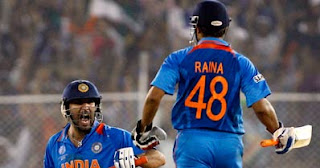 India's Yuvraj Singh and Suresh Raina celebrate their win against Australia