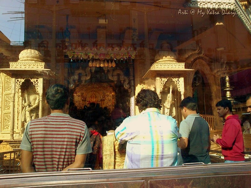 Prayers to Shreemant Dagduseth Halwai Ganpati Temple through the window, Pune - India