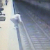 Woman caught on tape pushing husband's side chic in front a moving train... Graphic video