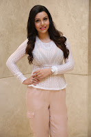 Kyra Dutt in Tight White Top Trousers at Paisa Vasool audio success meet ~  Exclusive Celebrities Galleries 010.JPG