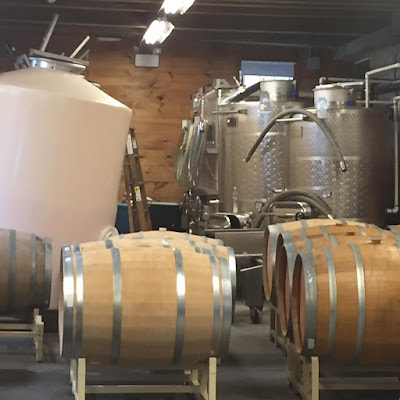 Stainless steel fermentation tanks and oak barrels at Truro Vineyards