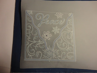 Parchment with frame, peace, snowflakes and colour with pencils and distress markers, from the front