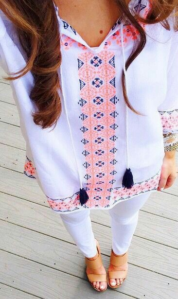 Embroidered top with white tight trouser