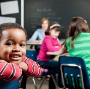 Smiling black-pupil at school