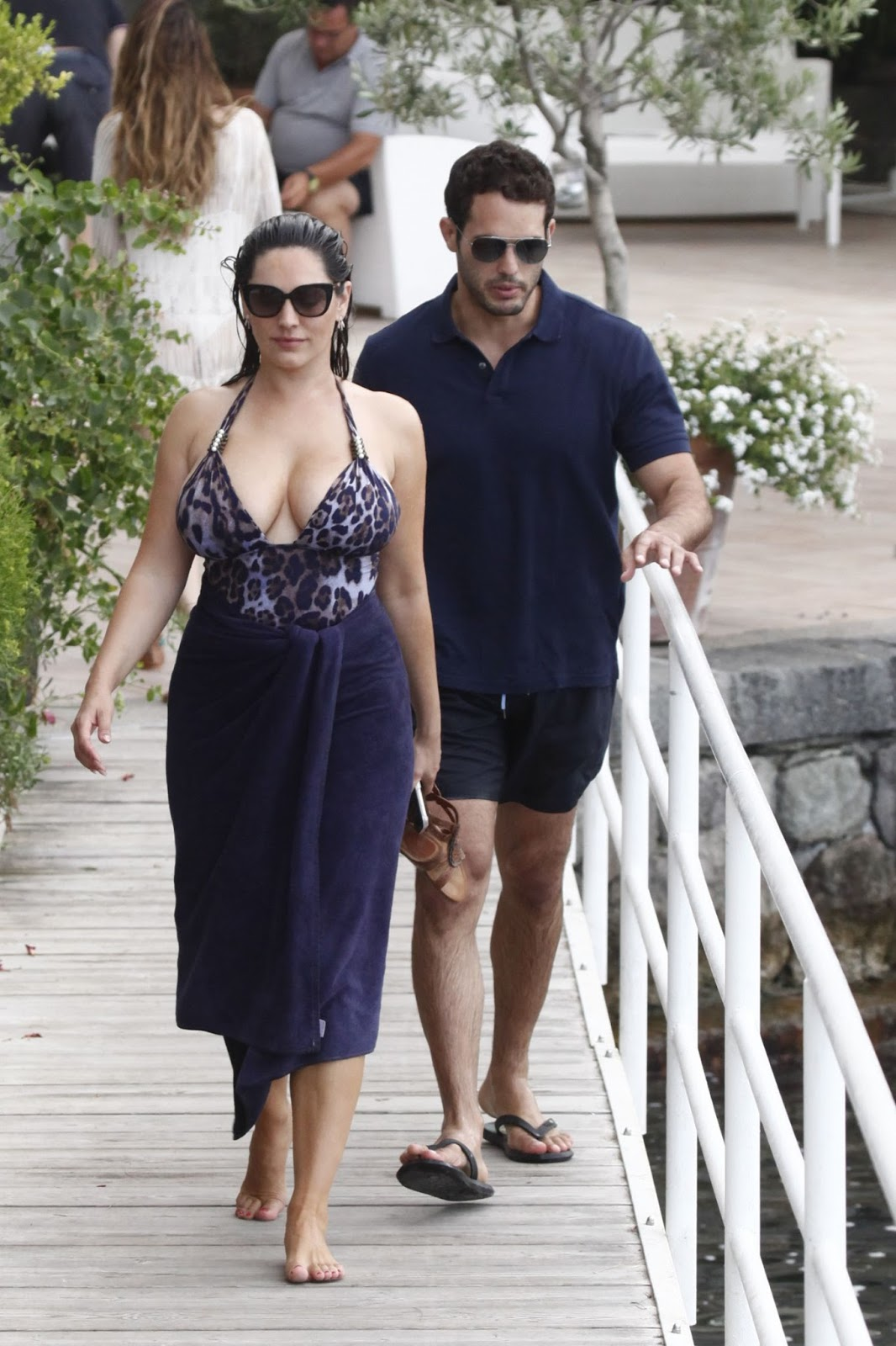 Kelly Brook wears a leopard print swimsuit in Italy