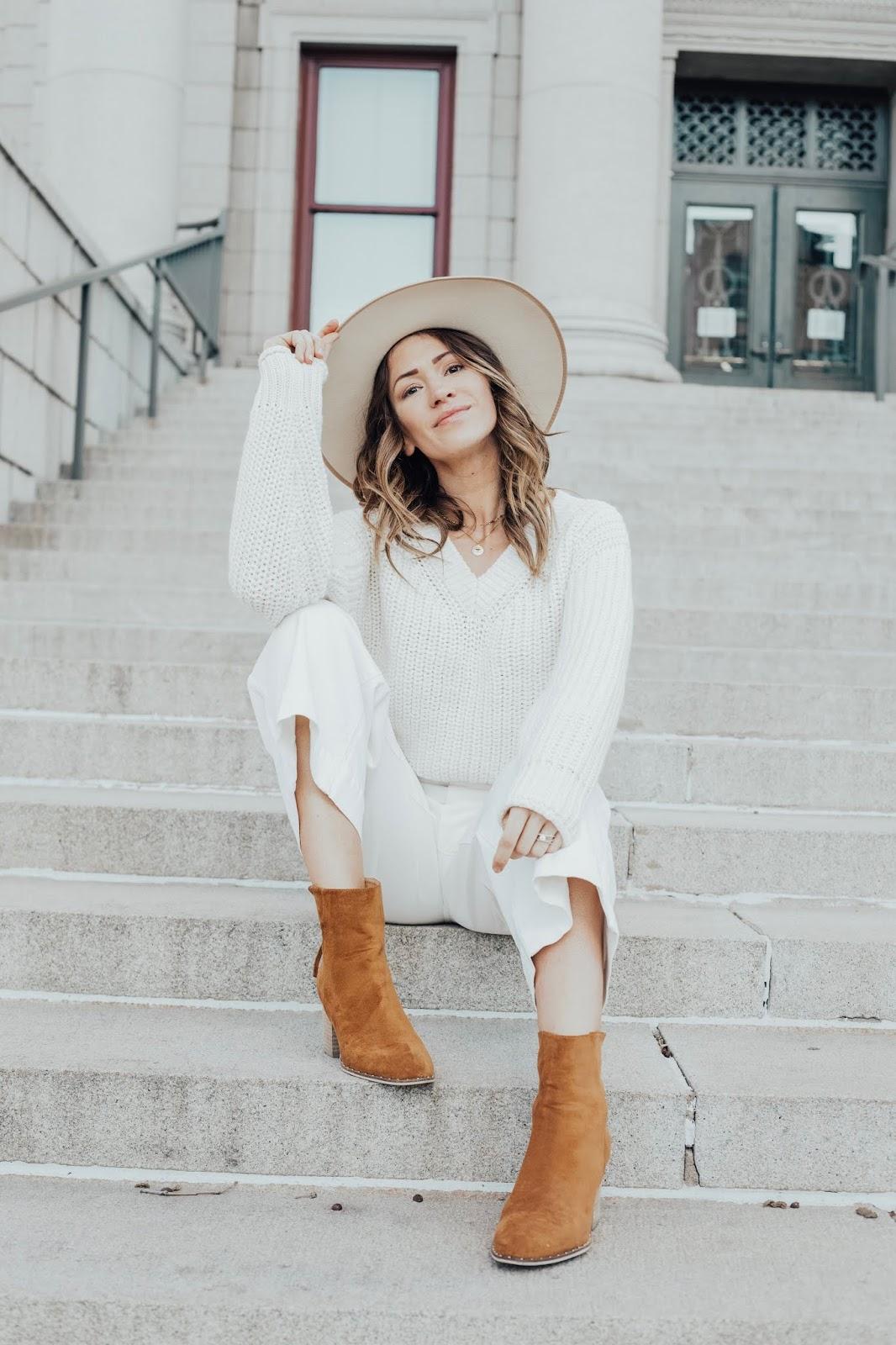 white sweater white hat white jeans