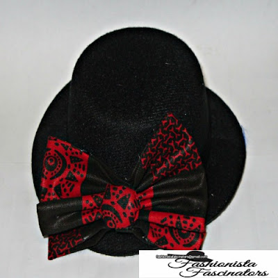 black fascinator hat with a black and red African print bow tie Nairobi Kenya
