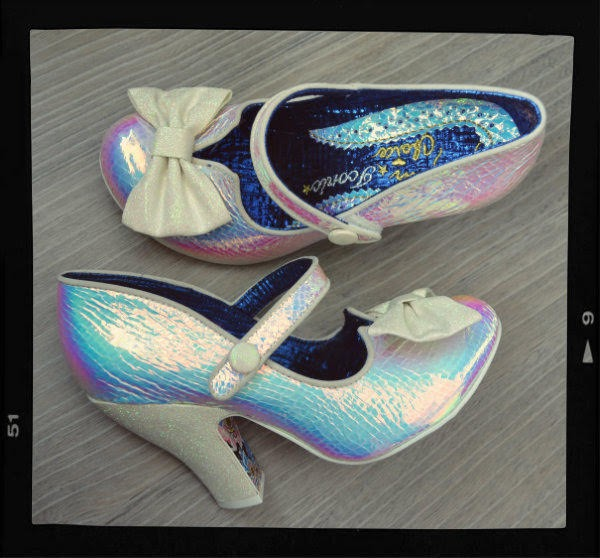 holographic glitter mary jane shoes with bows on floor