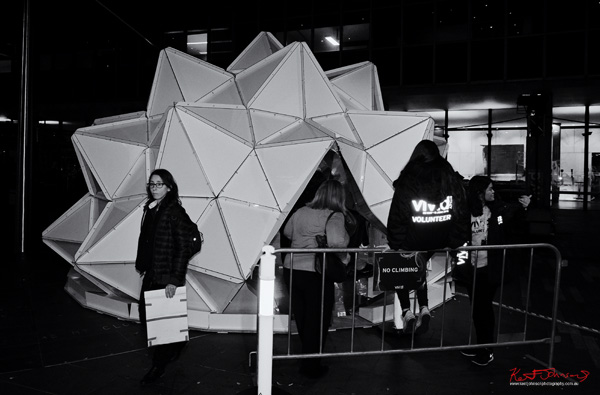Outside Light Origami, Vivid Sydney 2015. Street Photography in Black and White by Kent Johnson.