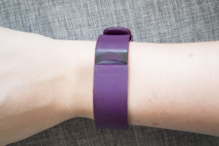 Purple Fitbit Charge HR on wrist.