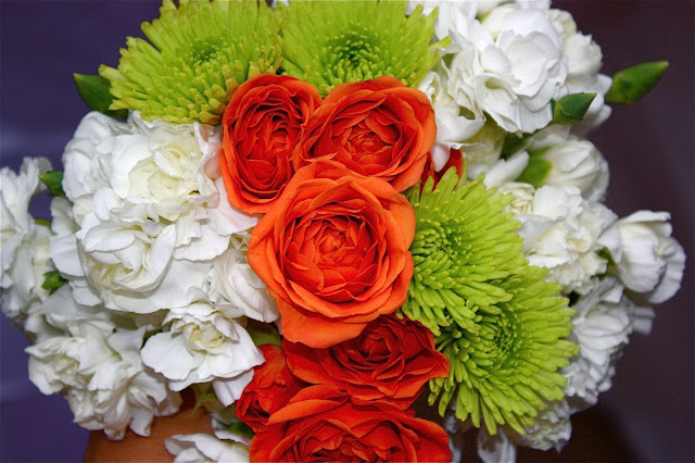 My homemade grocery-store bridal bouquet, made with baby white carnations, orange tea roses, and chartreuse baby mums