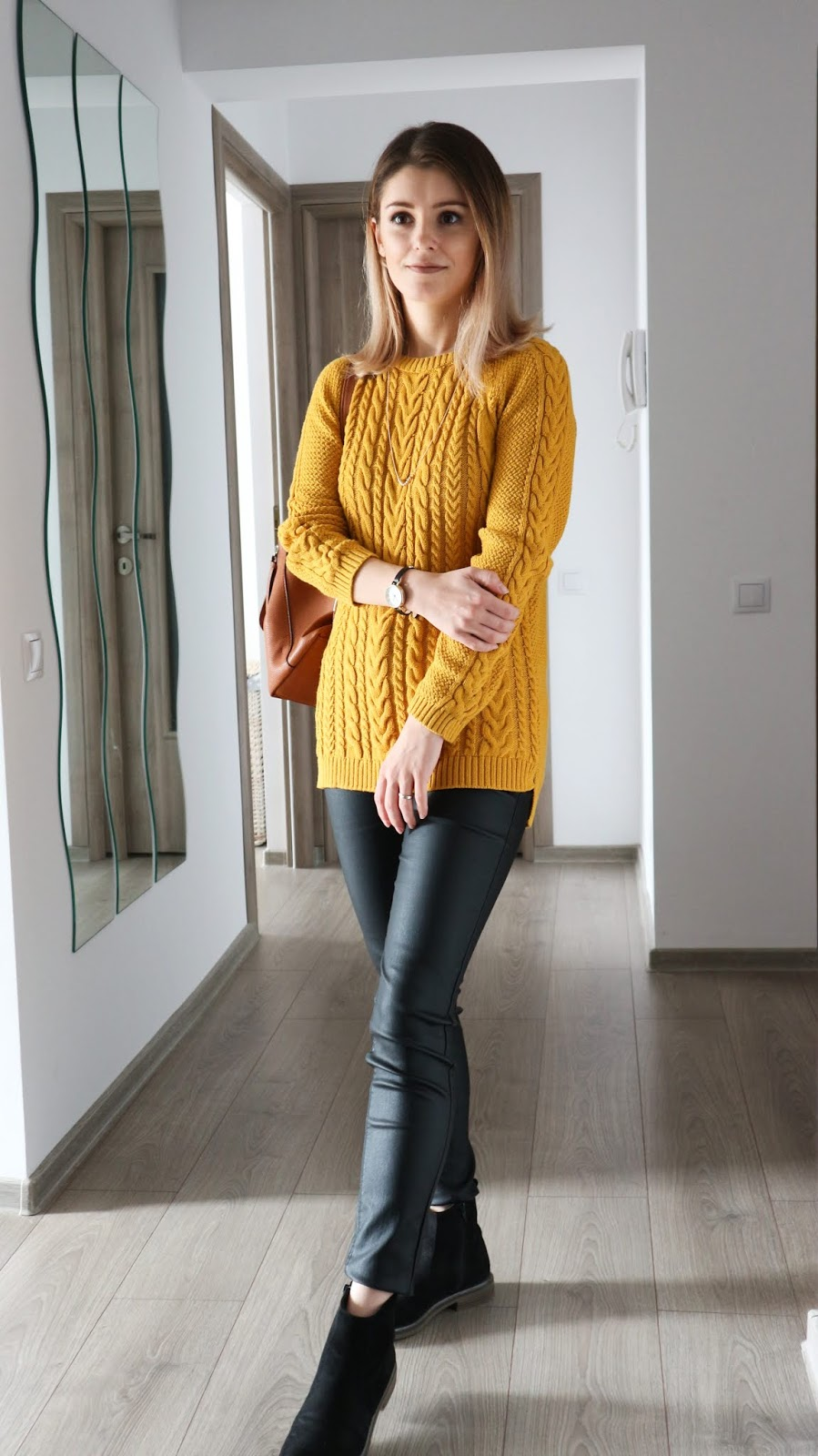 cable knit jumper with coated jeans style