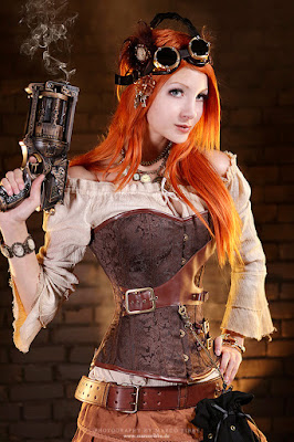 This is an example of how overbust corsets are used in women's steampunk fashion. This woman is wearing her overbust corset with a peasant blouse, skirt, belt and goggles.