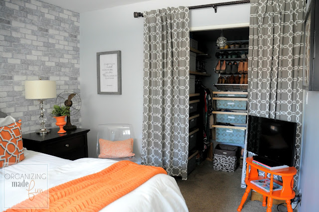 Gray and Orange Master Bedroom with faux brick wall