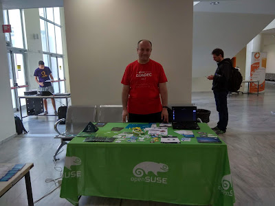 FOSSCOMM day 1, openSUSE-GNOME-GNUHealth booth