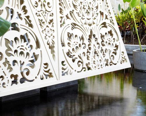 www.Tinuku.com Airmas Asri apply Balinese carvings and paintings on facade GRC material at Ananta Legian Hotel