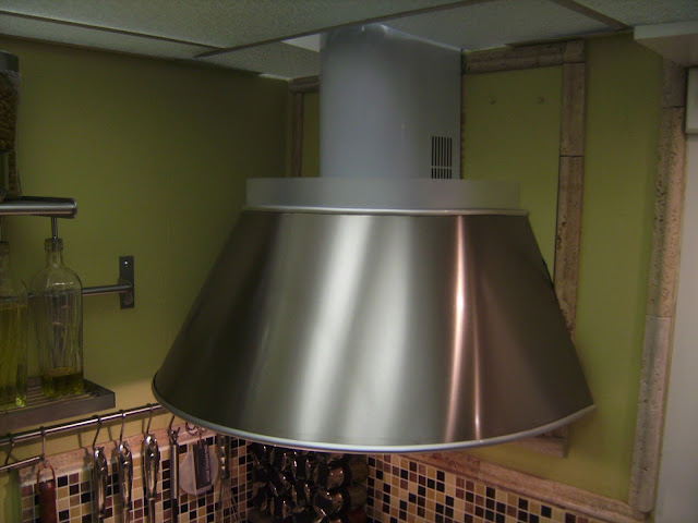 How to Remodel and Decorate a Small Kitchen, Adding a Range Hood, applying back splash
