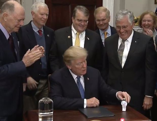 President Trump signs new order to send American astronauts to the moon