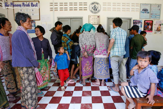 Villagers in Battambang's Roka commune gather to receive HIV testing following an outbreak of the virus in 2014. Heng Chivoan