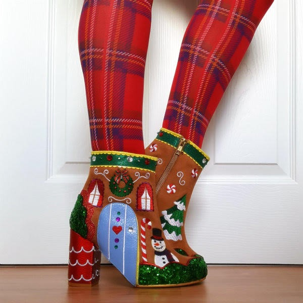 side angle of tartan tights on legs wearing gingerbread house themed ankle boots
