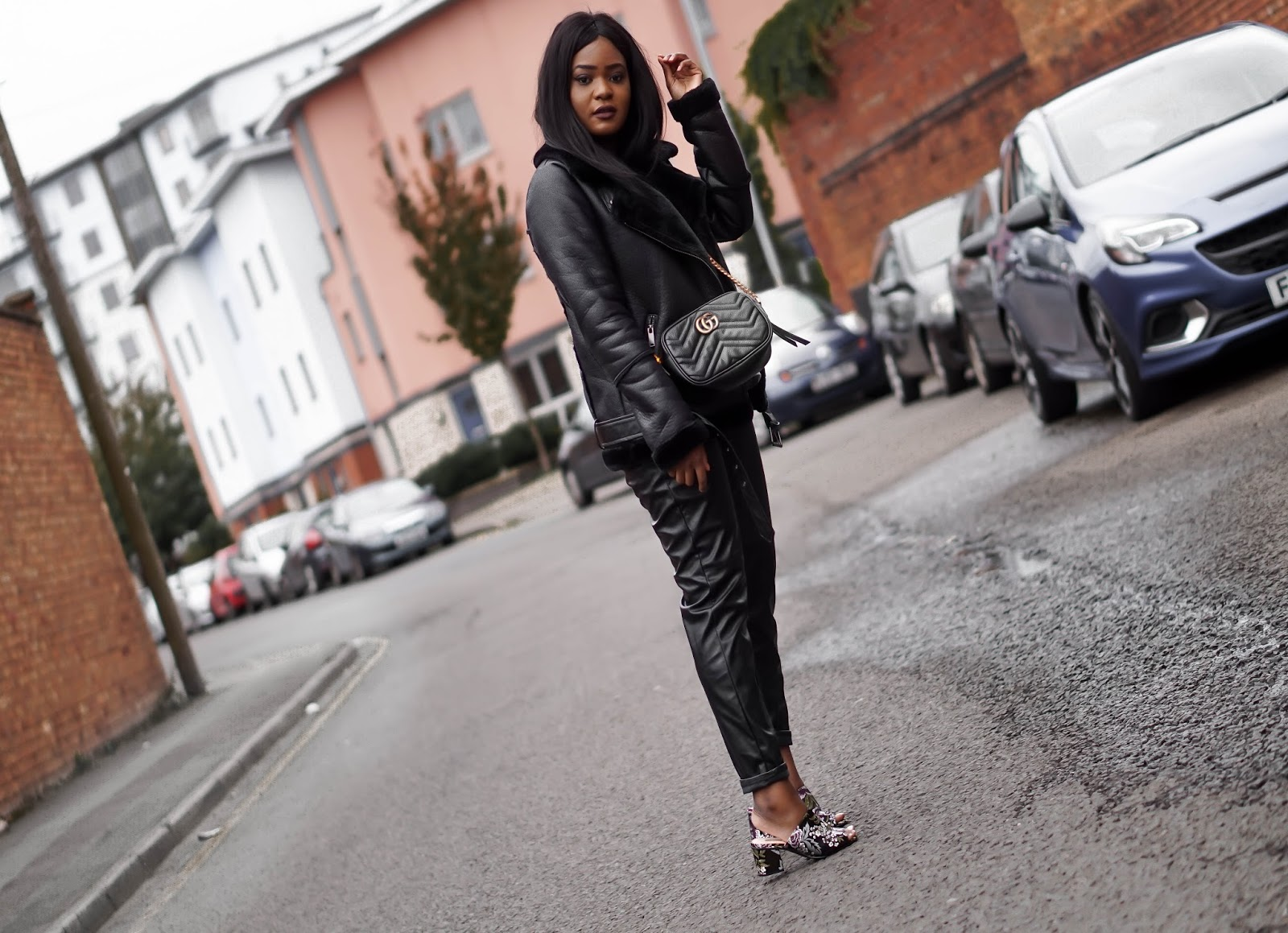 Patricia posing wearing a Primark aviator leather trimmed shearling biker jacket