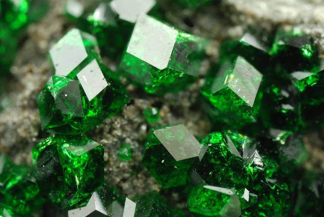 Gorgeous Green uvarovite crystals on chromite matrix from Ural, Russia. Photo: R. Tanaka