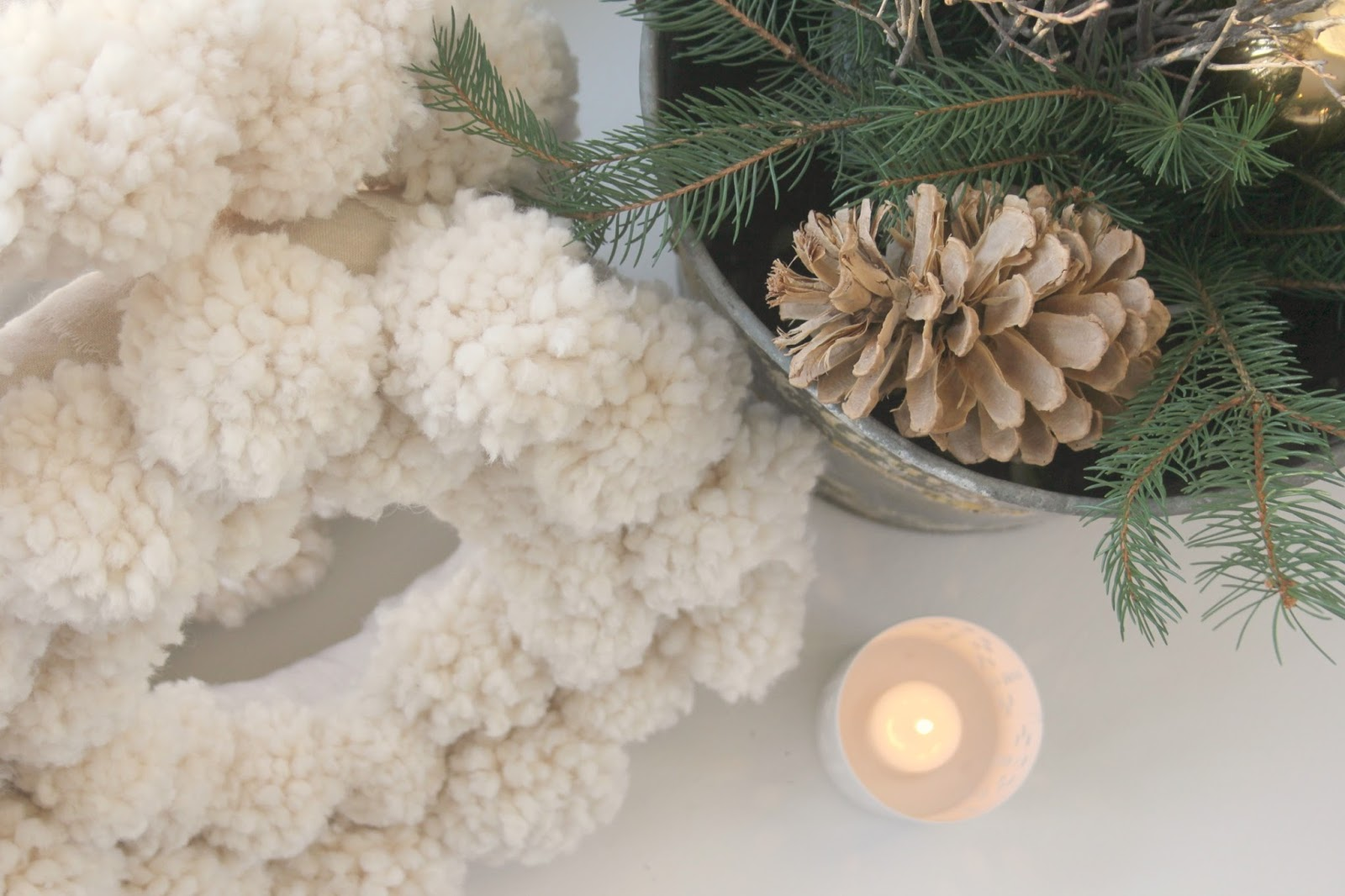 Hello Lovely Studio Christmas decor with pom pom wreaths and greenery