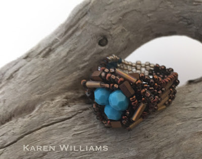 an alternate view of the Robin's Nest ring by Karen Williams