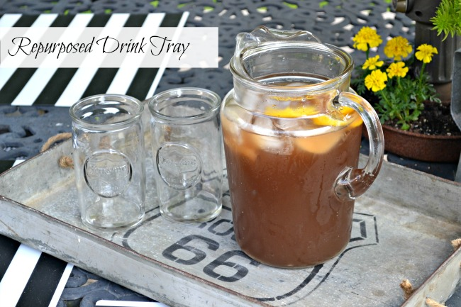 Iced tea in tray with glasses and overlay