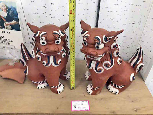 Black, white and red clay Shisa, pair