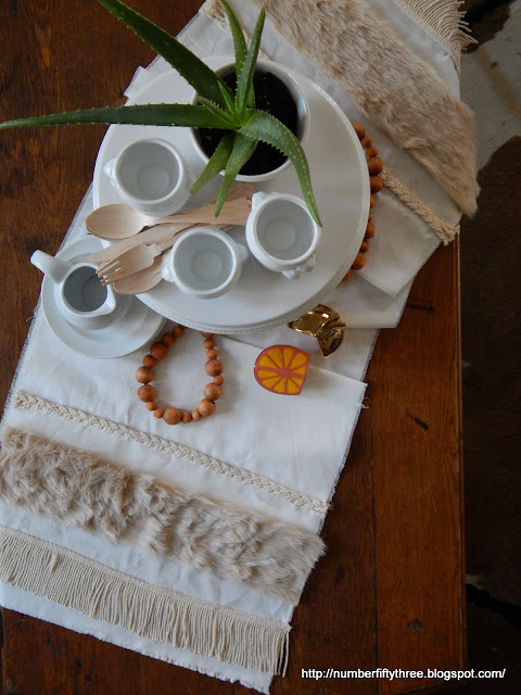Make a fun boho faux fur trimmed table runner for table top decor