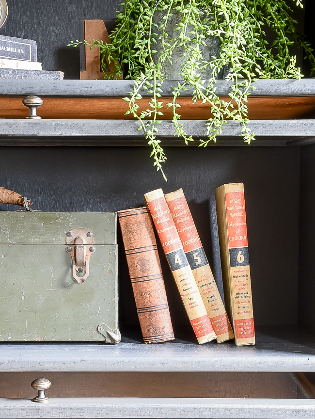 Vintage books styled in a painted barrister bookcase