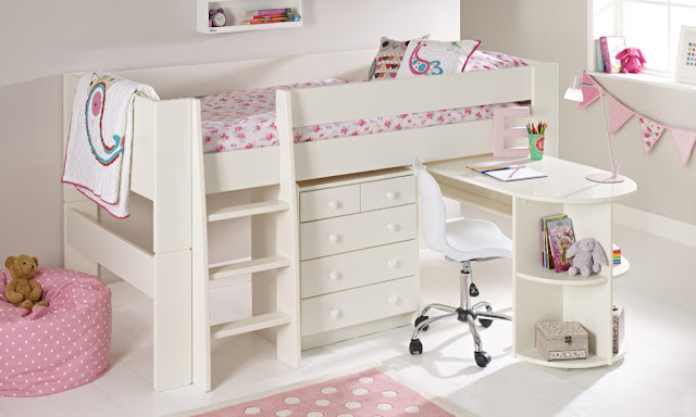 A white cabin bed with drawers underneath and a desk