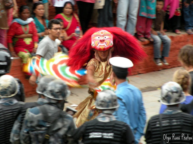 A dancer wearing traditional ritual mask during celebrations of Indra Jatra festival in Nepal
