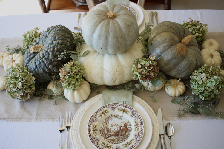 neutral fall tablescape gorgeous with green and white pumpkins and eucalyptus