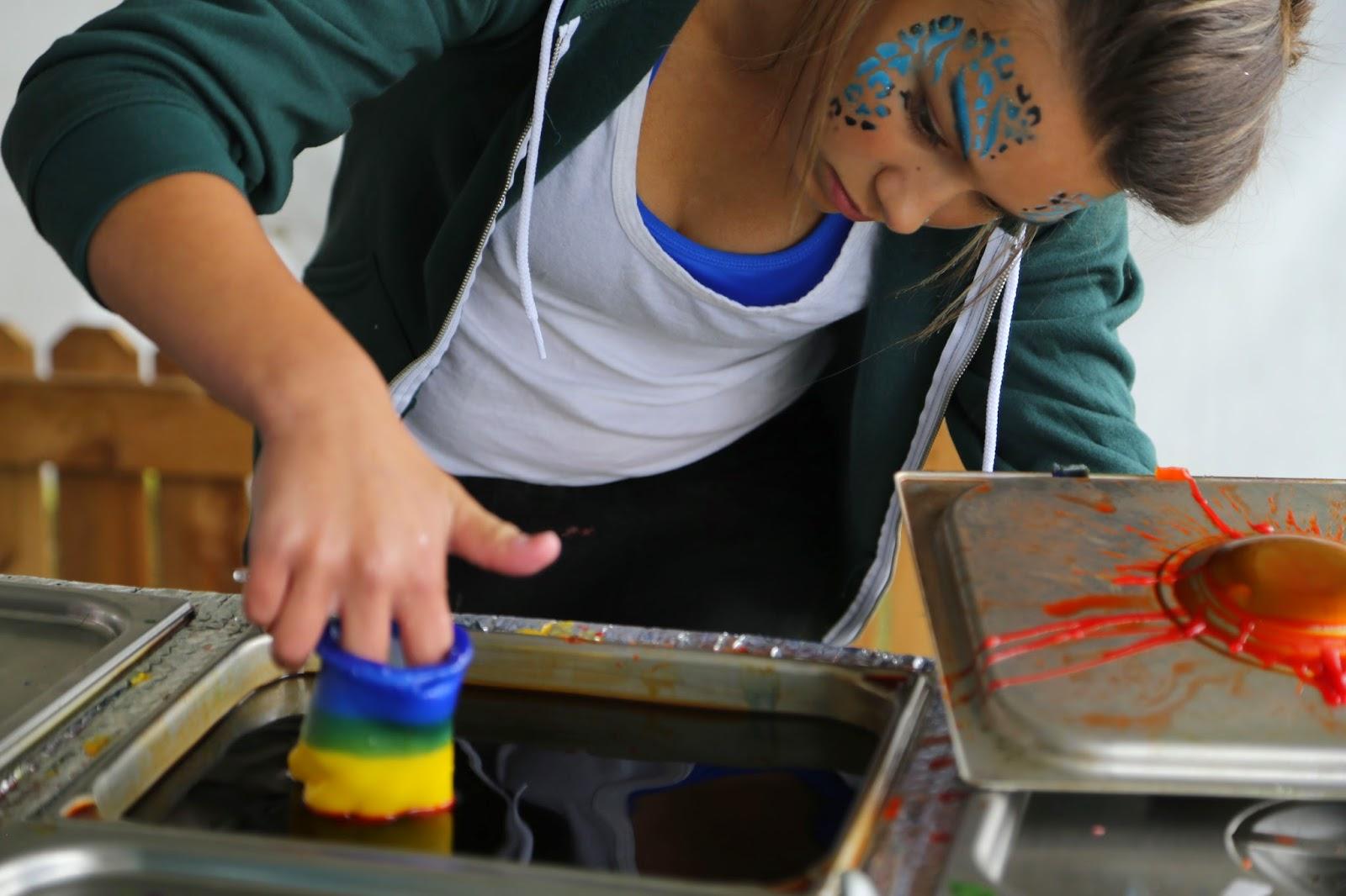 Dipping a wax hand in coloured wax, Alaska State Fair