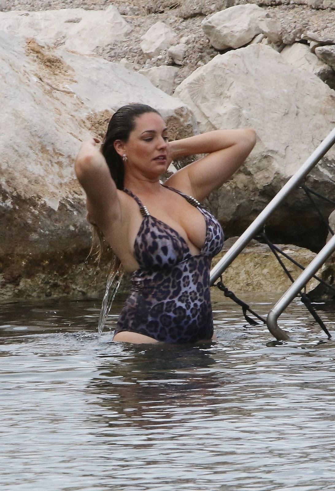 Kelly Brook wears a leopard print swimsuit in Italy