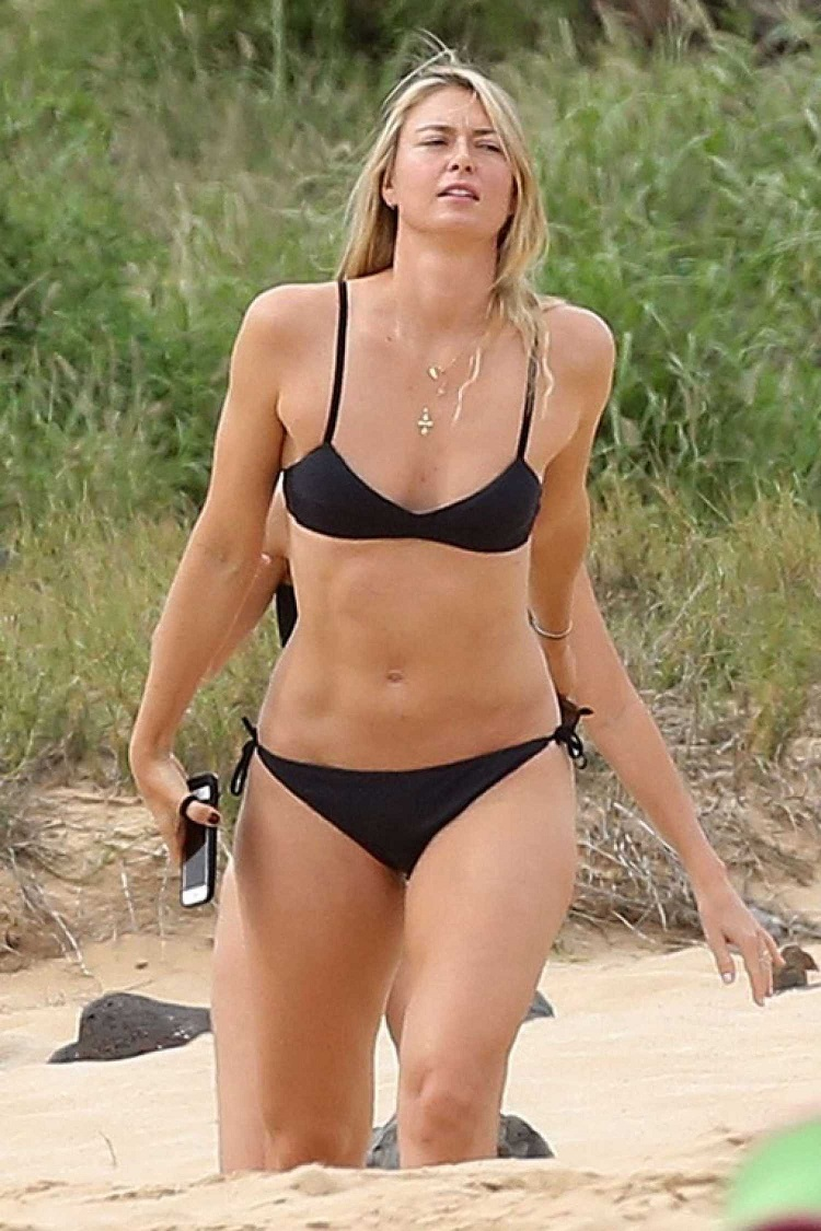 Maria Sharapova shows off fabulously toned physique in tiny black bikini as suspended tennis pro vacations in Hawaii