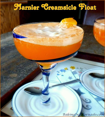 A cool refreshing summer cocktail, this Marnier Creamsicle Float is orange liqueur flavored ice cream floating in spiked orange soda. | Recipe developed by www.BakingInATornado.com | #recipe #cocktail
