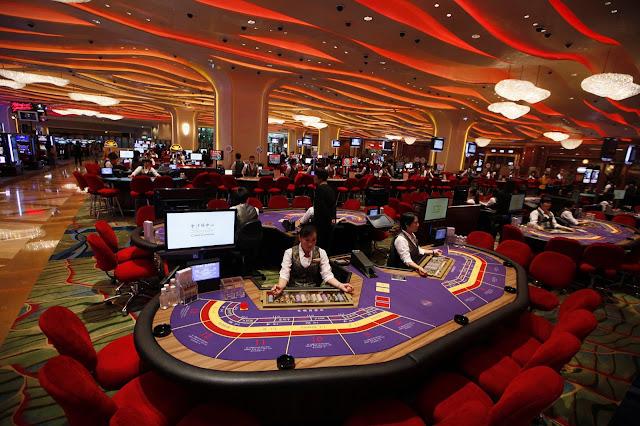 Macau's casino company wants to call half a billion dollars in virtual money p1