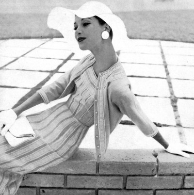 Model in two piece striped Adele Simpson design for January 1956 Vogue Ad