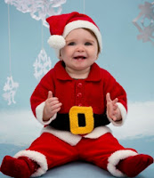 http://www.redheart.com/free-patterns/santa-baby-suit
