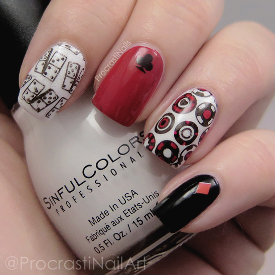 Casino nail art featuring red, white and black polish with stamping and decals